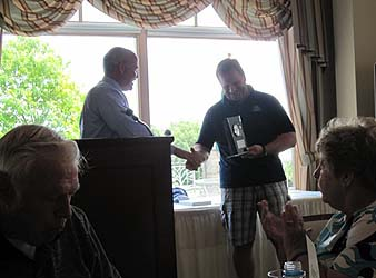 Scott Pitoniak receiving a recognition gift for his years of service to the club and the past eight as an officer