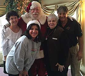 Press-Radio Club members, Cathy DiMarco, Debra Bonsignore, Pat Grover and Kids Miracle Making Club Director, Steve Pellow with Santa Claus volunteering at Eagle Vale for the kid's club